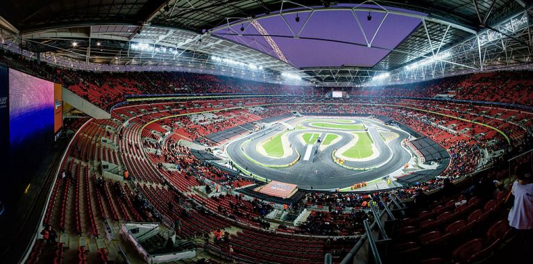 Wembley Stadium. Built on the remains of a folly (definitely), and a steam locomotive (possibly). By E01 from London, UK (Race of Champions at Wembley Stadium panorama) [CC-BY-SA-2.0], via Wikimedia Commons
