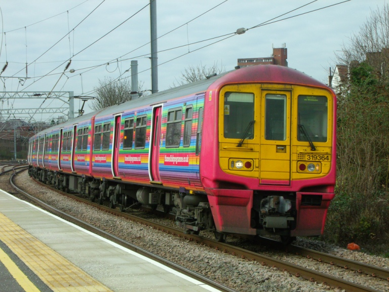 One of the First Capital Connect trains used on the Thameslink route, in Thameslink Programme. Seen at West Hampstead, London, UK, 16 February 2013. By Steven Hughes [CC BY- 2.0] via this flickr page