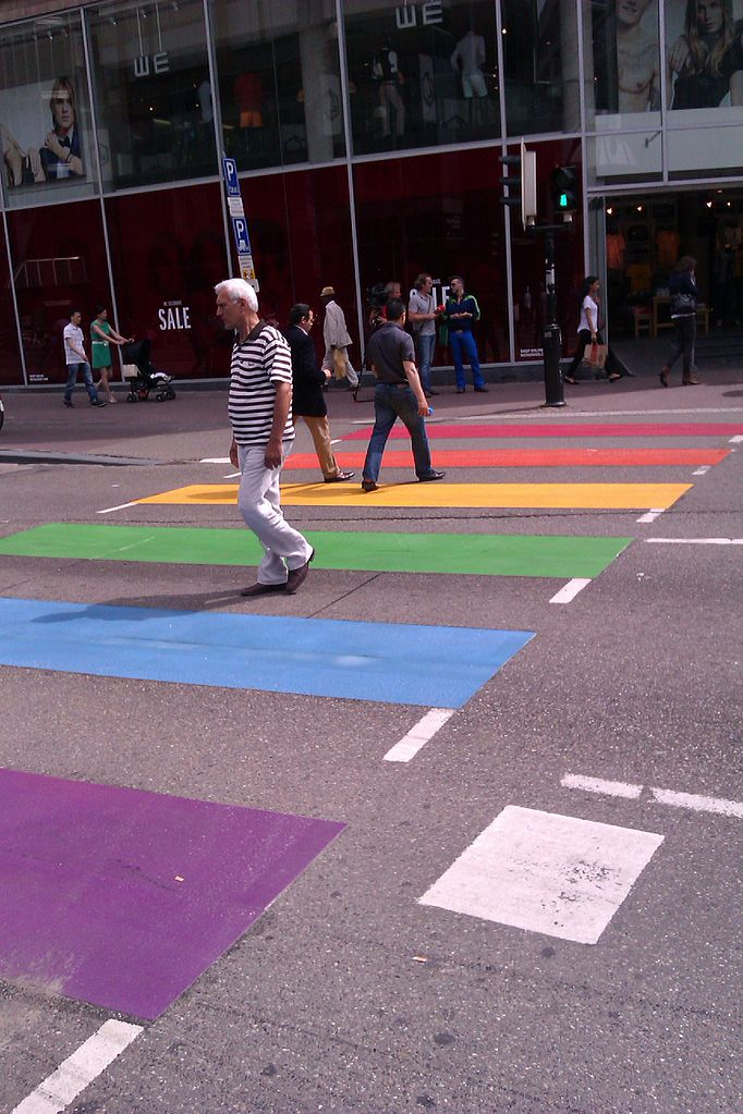 Pedestrian crossing painted in rainbow colours, Lange Viestraat, Utrecht, The Netherlands, June 19 2013. By Hansmuller (Own work) [CC-BY-SA-3.0], via Wikimedia Commons