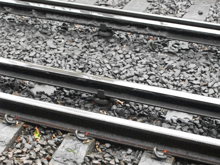 Third rail insulator pots at Woking, Surrey, UK. By Daniel Wright [CC BY-NC-ND 2.0]