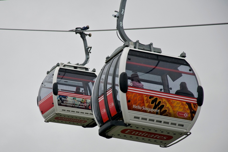 Cabins on the Emirates Air Line, with vinyls illustrating destinations served by the sponsor. By Martin Pettitt [CC 2.0] via this flickr page