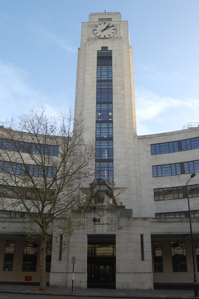 The National Audit Office building, previously the Empire Terminal, London. The central clock tower. By Daniel Wright [CC BY-NC-ND 2.0] via this flickr page
