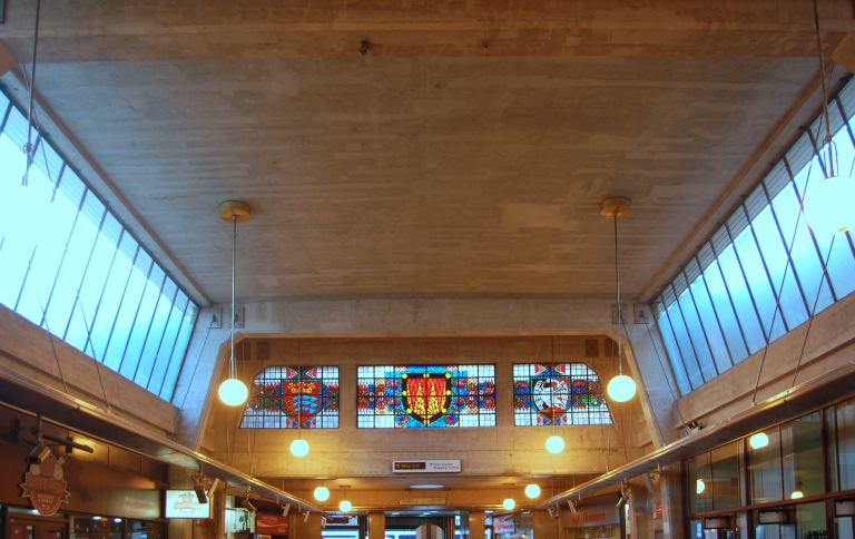 Stained glass panels in the ticket office at Uxbridge. By Daniel Wright [CC BY-NC-ND 2.0]