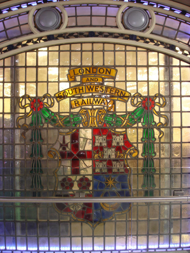 London and South Western Railway crest in stained glass, Waterloo Station, London. By Julian xxx [CC BY- 2.0] via this flickr page