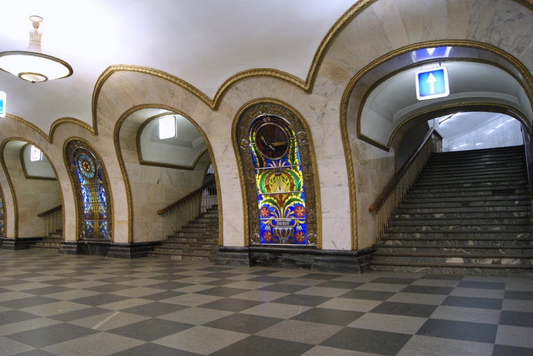 Stained glass panels at Novoslobodskaya station on the Moscow Metro. By Sergey Rodovnichenko [CC BY 2.0] via this flickr page
