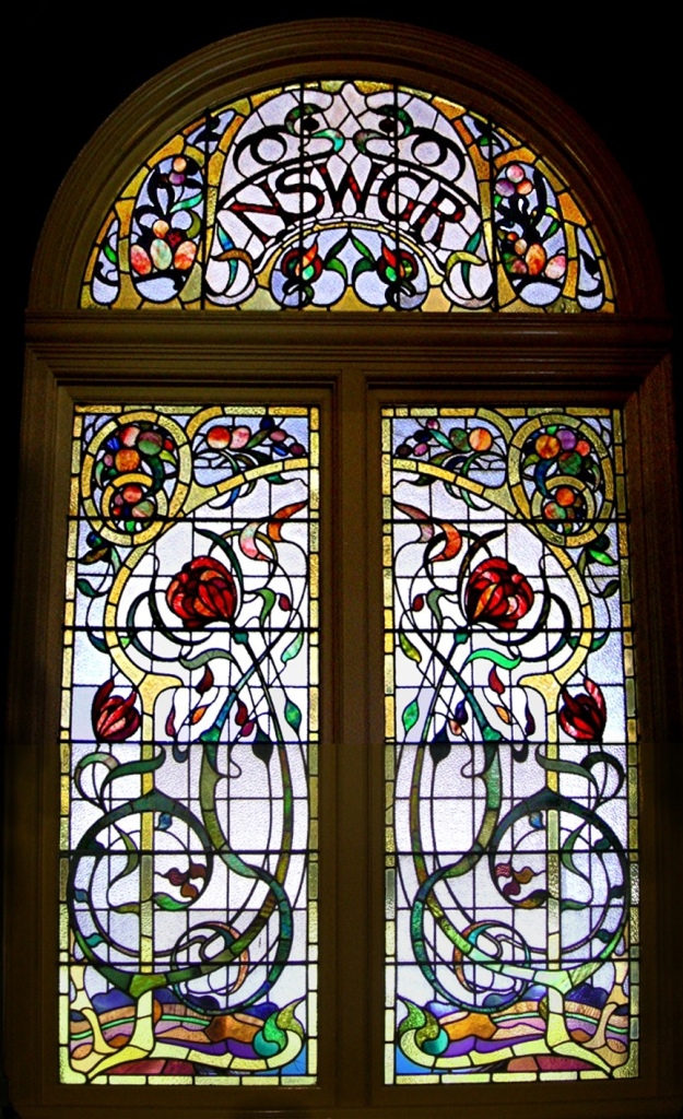 Window in the old ticket office at Sydney Central, Australia. By unknown, perhaps Radecki for Ashwin and Co. (photo TTaylor) [Public domain], via Wikimedia Commons