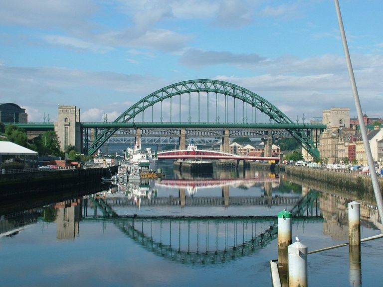 Bridges over the Tyne. Tyne Bridge in the foreground, withe the swing bridge. Photo by Tagishsimon (Own work) [CC-BY-SA-3.0-2.5-2.0-1.0 or GFDL], via Wikimedia Commons