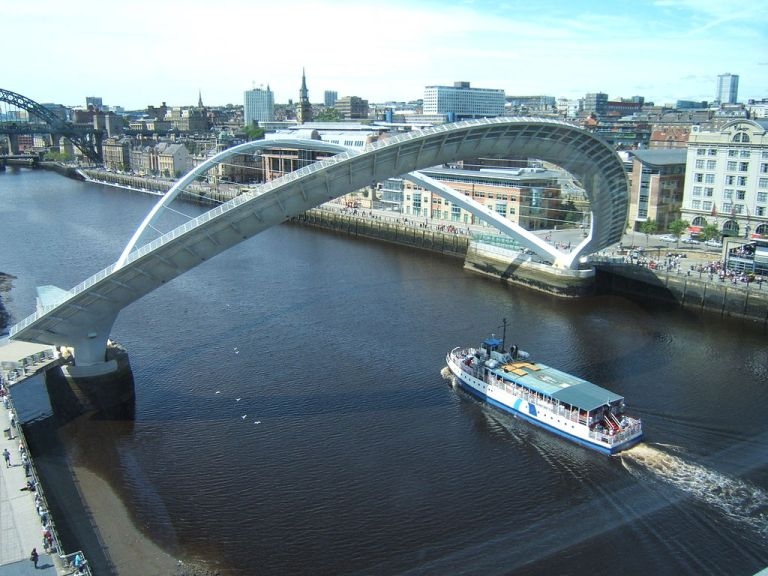 Boat passing under the raised Gateshead Millennium Bridge. Barbara Carr [CC-BY-SA-2.0], via Wikimedia Commons