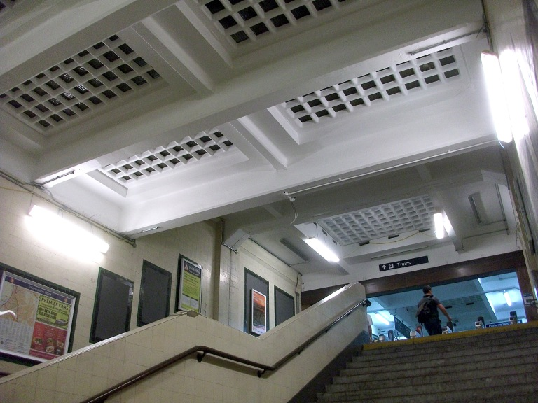 Looking up from the ticket hall into the footbridge at Surbiton station (July 2014). Photo by Daniel Wright [CC BY_NC_ND 2.0] via this flickr set