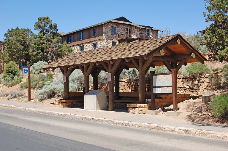 Bus shelter opposite Grand Canyon train depot. The branching supports made of logs echo those on the train depot. Photo by Daniel Wright [CC BY-NC-ND 2.0] via this flickr set