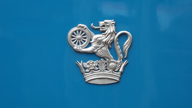 Cast aluminium version of the lion and wheel emblem. This is a modern reproduction on a locomotive restored to its original appearance. Photo by Steven Hughes [CC BY 2.0] via this flickr page