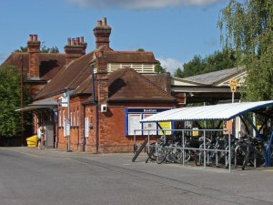 Bookham station, Surrey (the stationmaster's house is obscured behind vegetation). © Copyright Alan Hunt and licensed for reuse under this Creative Commons Licence