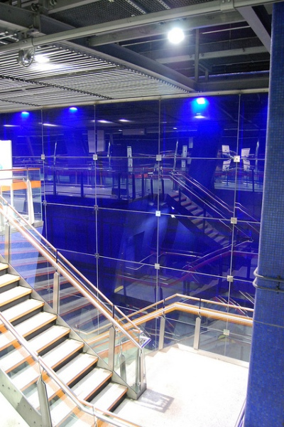 The blue glass wall at the edge of the station. It reflects the interior of the station, adding to the sensation that there is no firm 'edge' to the station. Photo by Daniel Wright [CC BY-NC-ND 2.0] via this flickr album