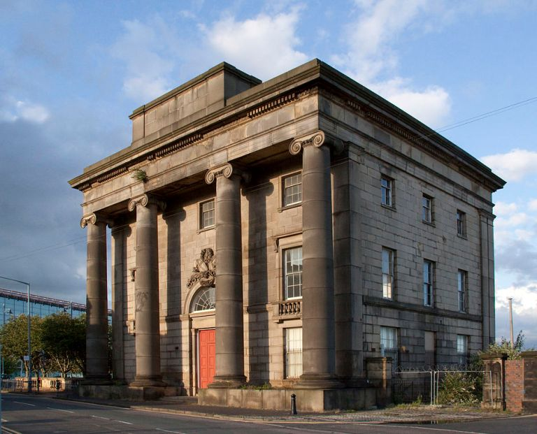 Curzon Street portico in 2009, standing in splendid isolation. The state of this building - one of the two termini of the first inter-city railway in the world  is a genuine embarassment to this country. Look at the buddleia growing out of the front. By Tony Hisgett [CC BY 2.0], via Wikimedia Commons