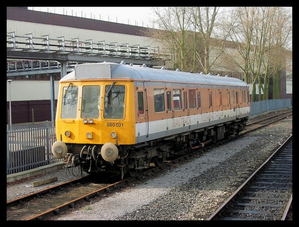 One of Railtrack's brown (teak style?) trains, complete with Gill Sans lettering along the side (Rail Alphabet for the numbers on the front, of course). Photo by R~P~M [CC BY-NC-ND 2.0] via this flickr page