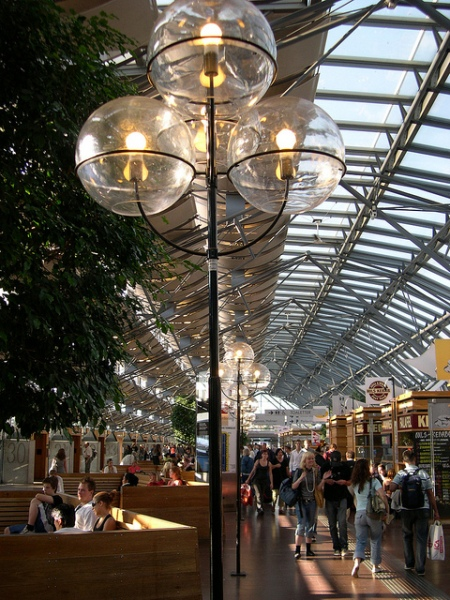 Inside Nils Ericson Terminal, streetlights and trees add to an outside-inside feel. Photo by Daniel Wright [CC BY-NC-ND 2.0] via this flickr album