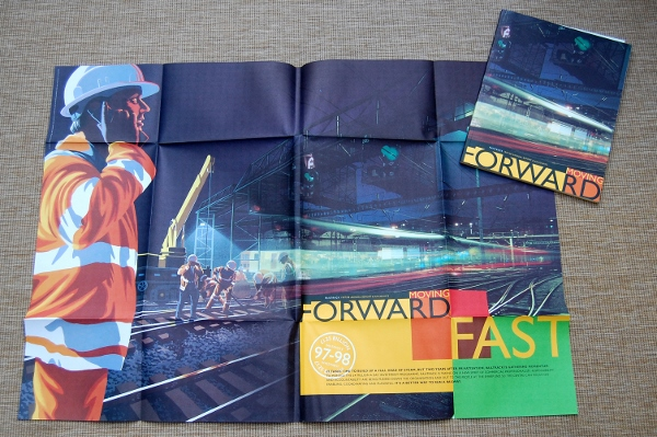 "Railtrack's 1997/98 Annual Report with its poster cover unfolded. ""Moving Forward Fast"" is by XXX and XXX"