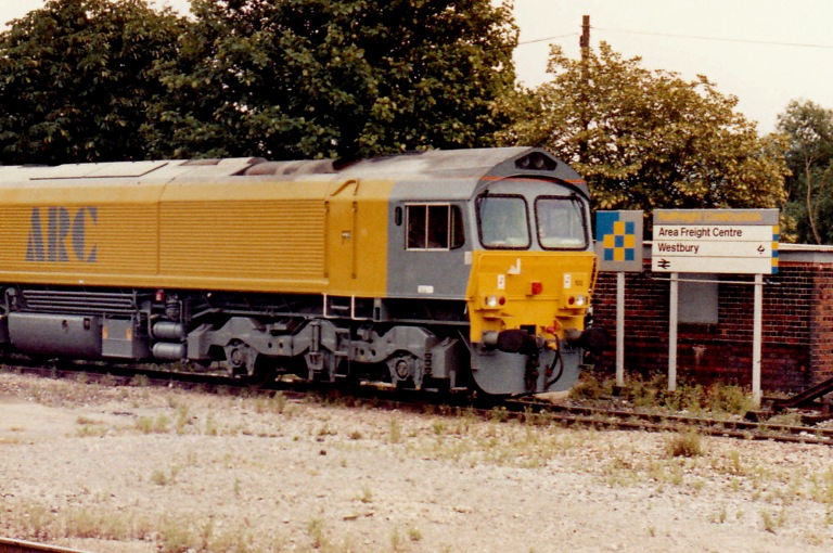 Railfreight's corporate identity as applied to signage, here seen at Westbury in 1991. The Railfreight Construction sub-sector logo gets a sign of its own. On the right, the use of Rail Alphabet typeface and the double arrow logo remain from British Rail's 196X corporate identity. However, new are the yellow on grey colours for