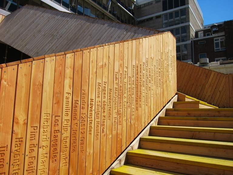 Some of the 8,000 boards crowdfunded by individuals which enabled construction of the Luchtsingel. © Ossip van Duivenbode [used with permission]