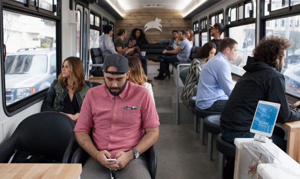 This is not a coffee shop, but the inside of a Leap Transit bus in San Francisco, California. There is a coffee shop inside the bus, though. This is an excellent example of rethinking the interior of a public transport vehicle, and offering something aspirational, and which a car can't offer. Photo courtesy of Leap Transit's press kit, via its website