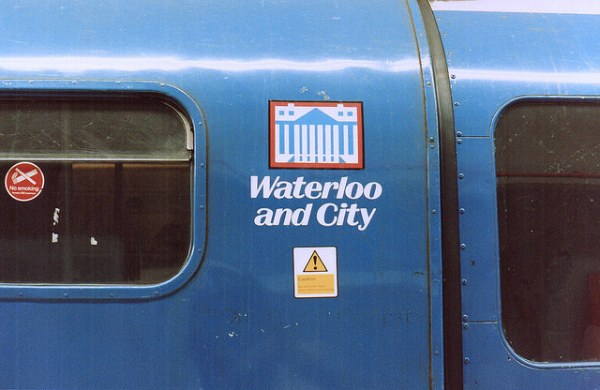Waterloo and City route badge. The design is a representation of the Bank of England building, on top of Bank station, the Waterloo and City's northern terminus. Photo by Daniel Wright [CC BYNC-ND 2.0] via this flickr page