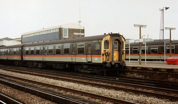 A London & SouthEast-liveried train at Ashford in May 1990. Photo by Paul Wright [CC BY-NC-ND 2.0] via this flickr page