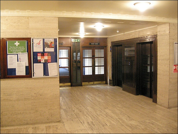 One of the lobbies at 55 Broadway, with splendid period details. Note in particular the wooden doors with bronze fittings, and the decorative coving. Photo by Hornet Arts [CC BY 2.0] via this flickr page