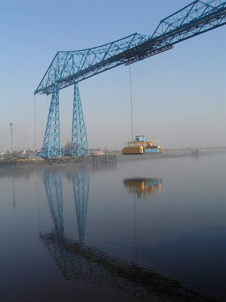 The Tees Transport Bridge's gondola crosses the River Tees. Photo by Lynn Pearson [CC BY 2.0] via this flickr page