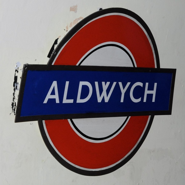 Roundel at Aldwych station with crossed W. Photo by Clare Griffiths [CC BY 2.0] via this flickr page