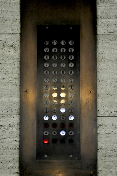 The proposed residential redevelopment of 55 Broadway promises to retain original fittings, so hopefully this gorgeous bronze lift indicator panel will survive. Photo by Phil Beard [cc BY 2.0] via this flickr page