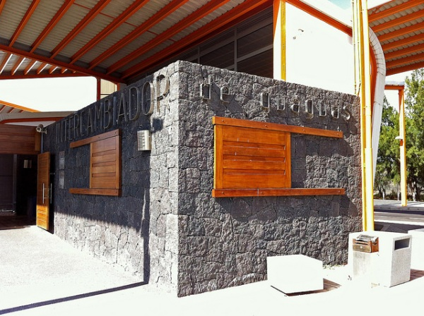 Lava blocks used for construction can be seen here. Wooden shutters for the windows, instead of opening on hinges, instead slide across. Photo by Daniel Wright [CC BY-NC-NSD 2.0] via this flickr album