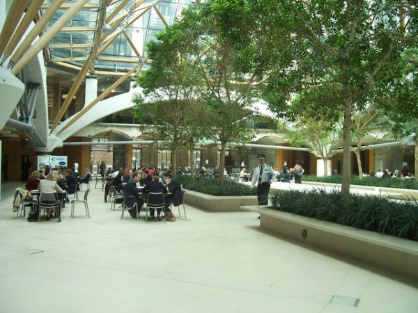 The atrium in Portcullis House. Photo by Lewis Clarke [CC BY-SA 2.0], via Wikimedia Commons
