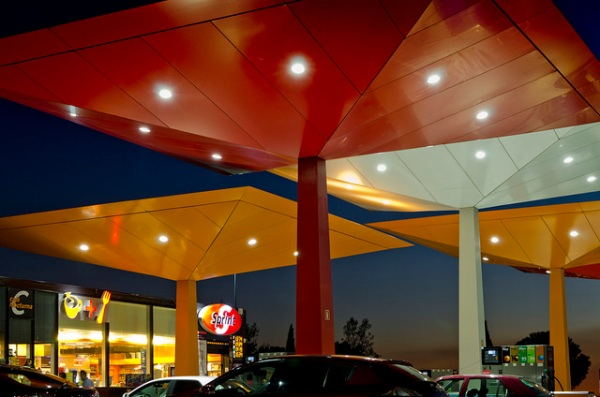 Repsol filling station at night. Photo by Repsol [CC BY-NC-SA 2.0] via this flickr album