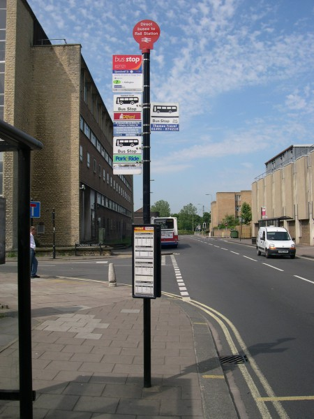 Bus stop in Oxford city centre, taken sometime between 2002 and 2006 while I was with Surrey County Council visiting colleagues in Oxfordshire County Council. Since then, Oxfordshire County Council has taken on responsibility for bus stop infrastructure and has replaced signs like this with something better designed.