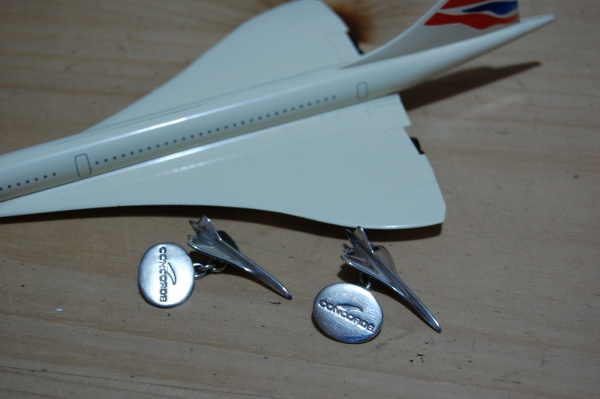 A pair of Concorde cufflinks, with a model Concorde behind. You used to be able to buy these from British Airways travel shops. Photo by Daniel Wright