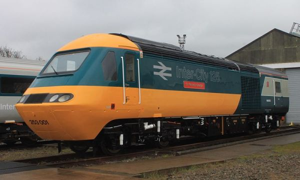 "The first InterCity 125 power car, repainted into its original colour scheme and named ""Sir Kenneth Grange"" in May this year. Photo by Geof Sheppard (Own work) [CC BY-SA 3.0 or GFDL], via Wikimedia Commons"