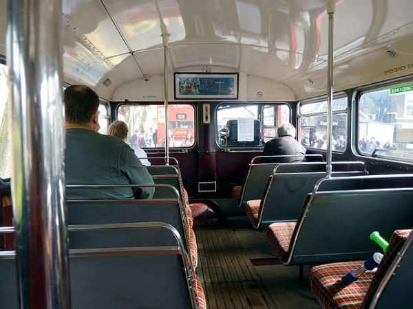 The cramped interior of a Routemaster's lower deck. Imagine trying to navigate it in a wheelchair. Photo by Linda Hartley from London, UK (Routemaster on the 101 route) [CC BY 2.0], via Wikimedia Commons