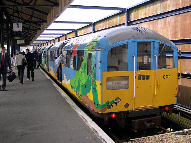 Island Line train in dinosaur colours. Photo by Daniel Wright [CC BY-NC-ND 2.0] via this flickr page