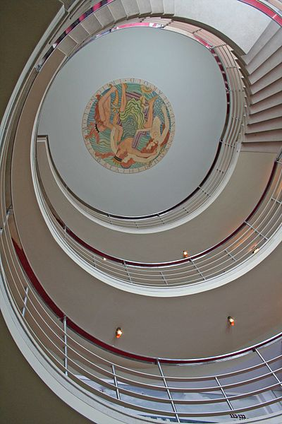Staircase and Gill ceiling panel. Photo by tom heyes from stockport, uk (Midland Hotel staircaseUploaded by Snowmanradio) [CC BY 2.0], via Wikimedia Commons