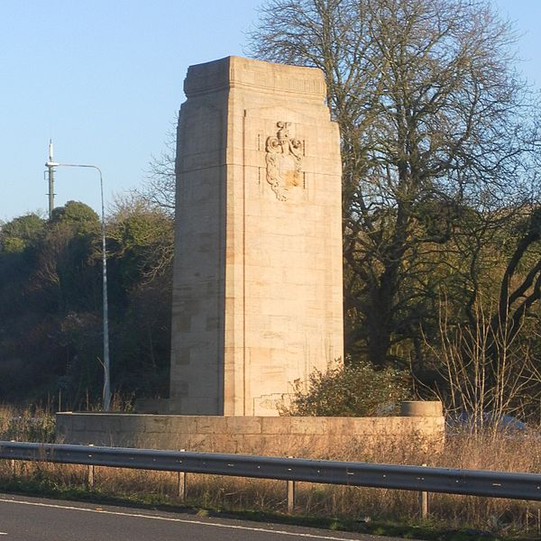 The west pylon and its seat, marooned in the central reservation of the A23. Photo by The Voice of Hassocks (Own work) [Public domain], via Wikimedia Commons