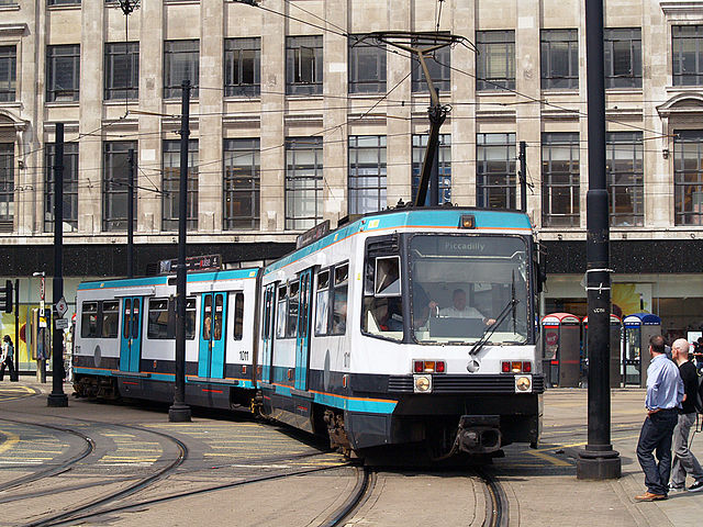 Manchester Metrolink tram in Manchester city centre. Photo by By David Ingham (originally posted to Flickr as P7257701) [CC BY-SA 2.0], via Wikimedia Commons