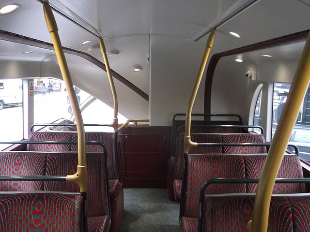 The upper deck of a New Routemaster, looking towards the rear. The back seat on the right is the worst offender in terms of headroom and ability to see out of the bus. David Anstiss [CC BY-SA 2.0], via Wikimedia Commons