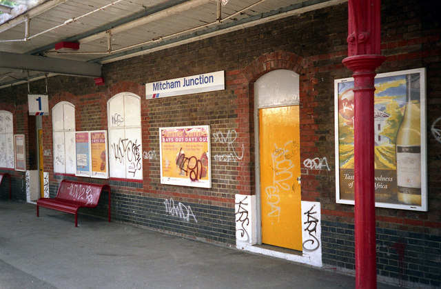 Mitcham Junction station in 2008, boarded-up, unattractive, and unsurprisingly targetted by graffiti vandals despite being 'historic' and 'attractive'. Photo by Dr Neil Clifton [CC BY-SA 2.0], via Wikimedia Commons